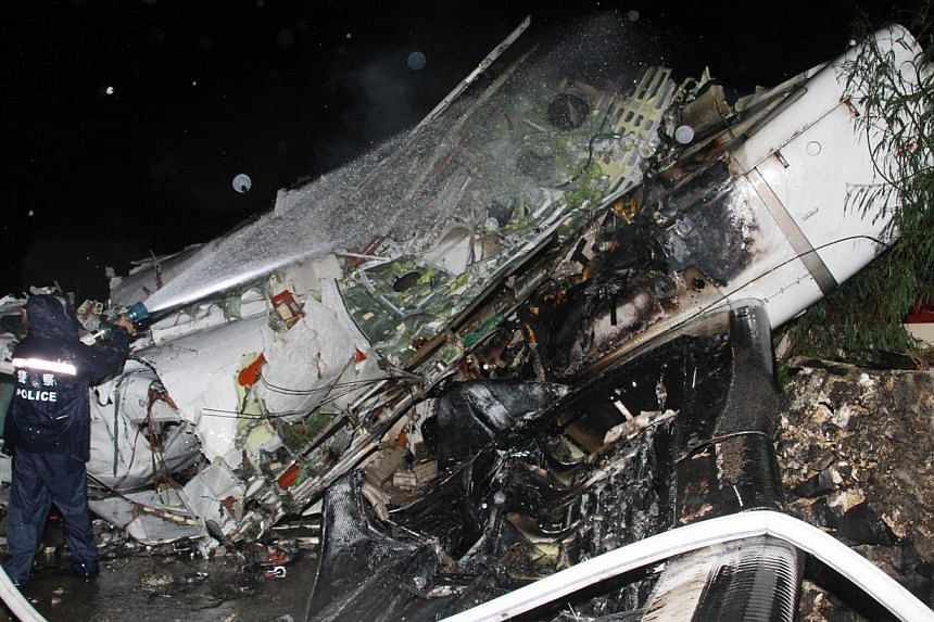 The wreckage of the TransAsia Airways Flight GE222 after it crashed in Penghu island on July 23, 2014. -- PHOTO: AFP