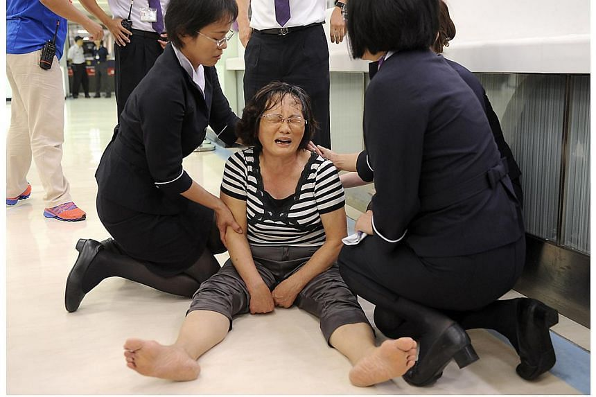 A relative of a passenger on board the crashed TransAsia Airways plane cries in Kaohsiung International Airport, southern Taiwan, on July 23, 2014. -- PHOTO: REUTERS