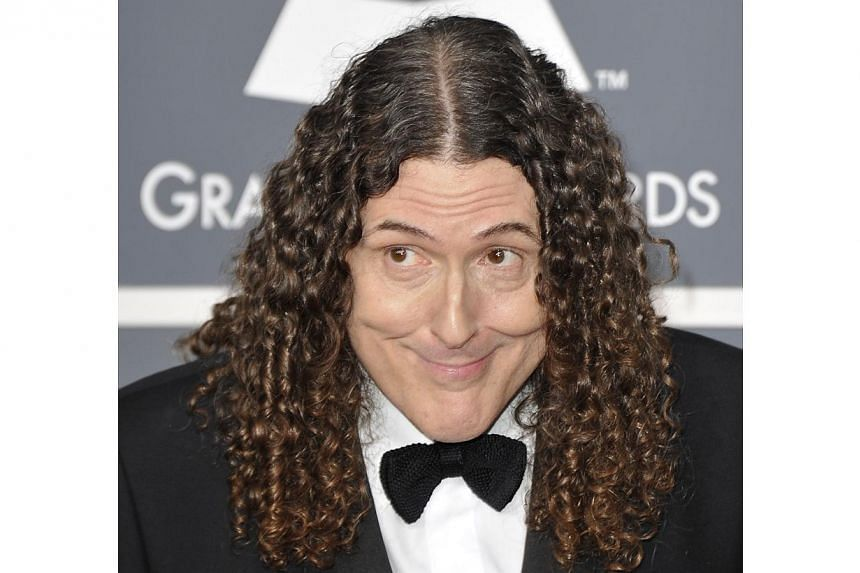 "In this 2012 file photo, US comedian-singer ""Weird Al"" Yankovic arrives at the Staples Center for the 54th Grammy Awards in Los Angeles, California. ""Weird Al"" Yankovic on July 23, 2014 has scored a career-first number one album following a viral vid"