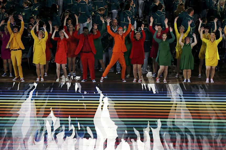 Dancers perform during the opening ceremony for the 2014 Commonwealth Games at Celtic Park in Glasgow, Scotland, on July 23, 2014. -- PHOTO: REUTERS