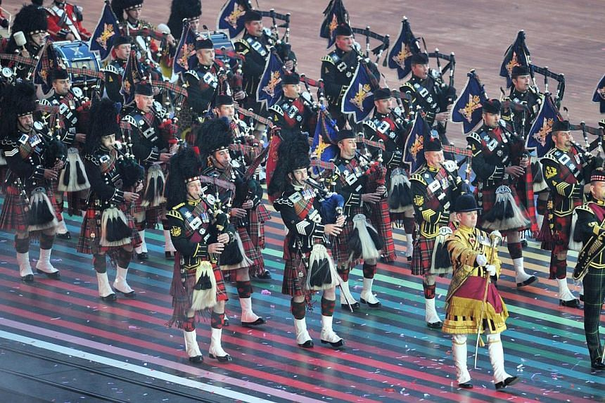A pipe band performs during the opening ceremony of the 2014 Commonwealth Games at Celtic Park in Glasgow on July 23, 2014. -- PHOTO: AFP