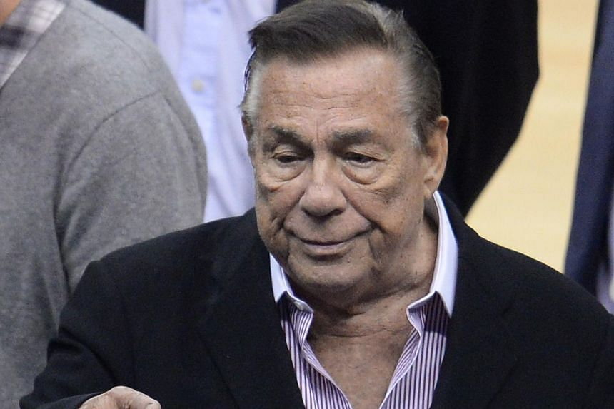 This April 21, 2014 file photo shows Los Angeles Clippers owner Donald Sterling attending the NBA playoff game between the Clippers and the Golden State Warriors at Staples Center in Los Angeles, California. -- PHOTO: AFP