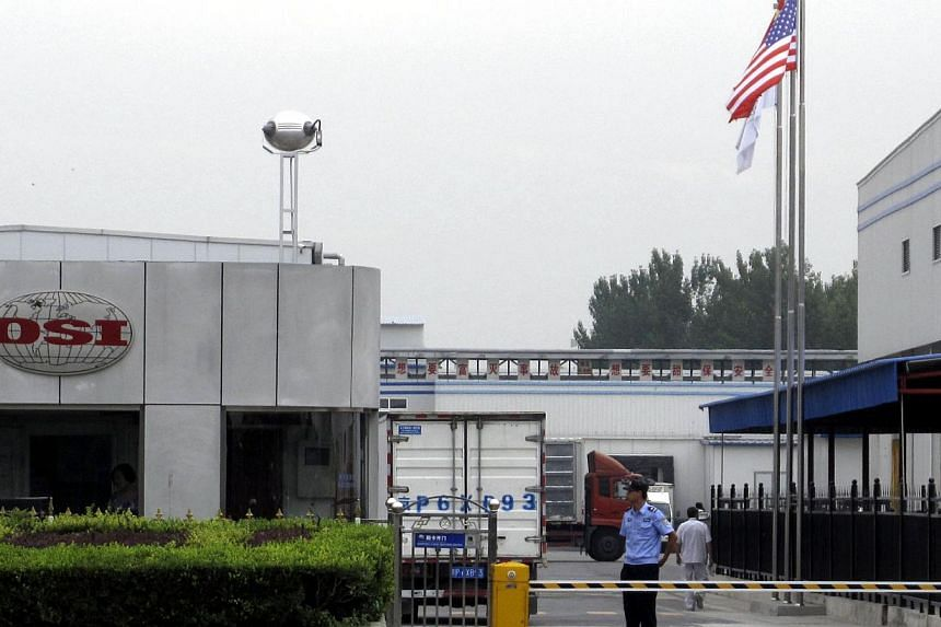 A security personnel stands guard in front of an OSI's food processing plants in Langfang, Hebei province, July 23, 2014. Shanghai police said on Wednesday they detained five people in an investigation into a Chinese-based supplier of foreign fast-fo
