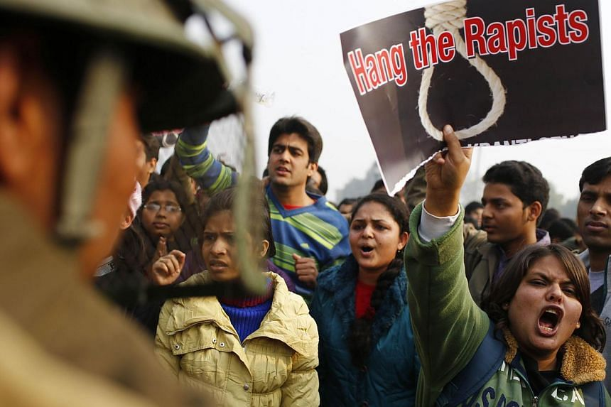 File picture of an Indian demonstrator shouting slogans at police while holding a placard calling for the death sentence for the rapists during a protest after the Delhi rape case.A seven-year-old girl was found hanging from a tree Thursday in