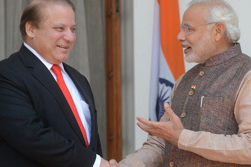 """Indian and Pakistani prime ministers Narendra Modi (R) and Nawaz Sharif shake hands during a meeting in New Delhi on May 27, 2014. India and Pakistan have directed their peace efforts towards """"trade diplomacy"""" in a bid to build enough trust to tackle"""