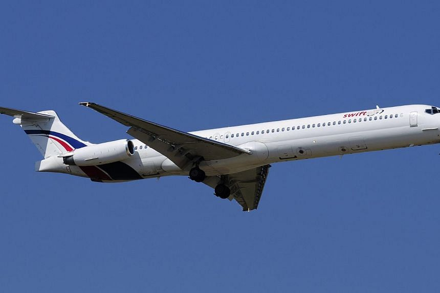 A Swiftair MD-83 airplane is seen in this undated photo.There were likely many French passengers on the Air Algerie flight which disappeared en route from Ouagadougou in Burkina Faso to Algiers, France's transport minister said. -- PHOTO: REUTE