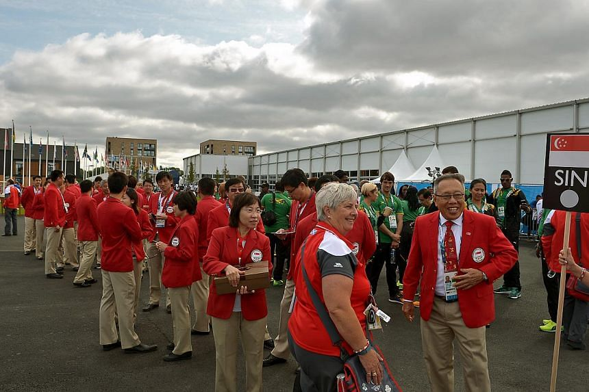 Singapore athletes waiting to make their way to the welcome ceremony held at the international zone of the games village on July 21,2014. -- ST PHOTO: KUA CHEE SIONG