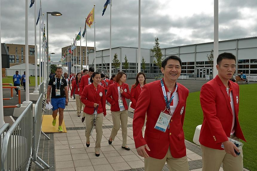 Singapore athletes make their way to the welcome ceremony at the games village on July 21, 2014. -- ST PHOTO: KUA CHEE SIONG