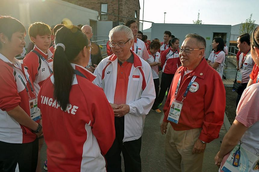 President Tony Tan speaks with table-tennis player Isabelle Li (fourth from right) as he visits the Singapore athletes at the games village in Glasgow, Scotland, a day before the opening ceremony of the 2014 Commonwealth Games. -- ST PHOTO: KUA CHEE