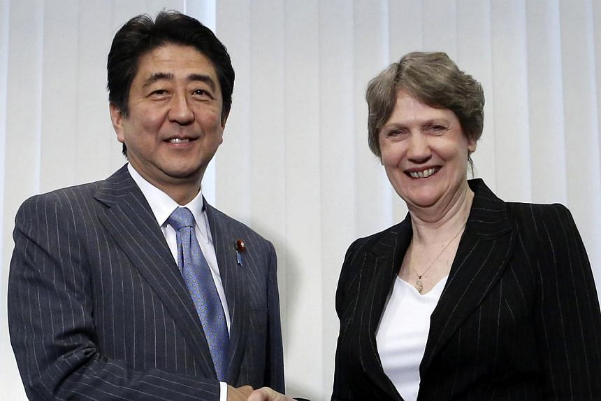 United Nations Development Programme (UNDP) Administrator Helen Clark (right) shakes hands with Japan's Prime Minister Shinzo Abe at the start of their meeting, ahead of the Global Launch of Human Development Report 2014 at the United Nations Univers