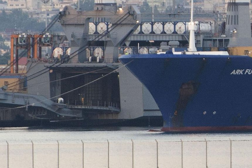 Danish ship Ark Futura (right) is docked next to US ship Cape Ray at the port of Gioia Tauro, southern Italy, on July 2, 2014 for the transfer of chemical weapons from Syria to be destroyed.All the toxic chemicals removed from Syria under a dea