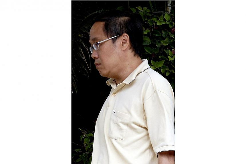 Teh Thian Seng, 50,a former engineer who took upskirt videos of unsuspecting women on escalators at shopping malls and MRT stations was jailed for three weeks on Friday, July 25, 2014. -- ST PHOTO:WONG KWAI CHOW