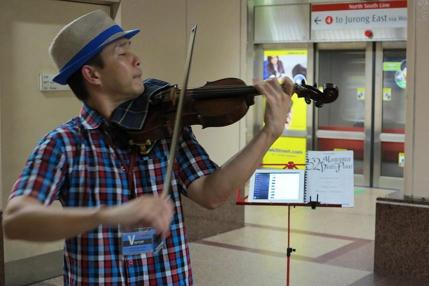 Part-time busker and tuition teacher Daniel Beng played tunes including Smoke Gets In Your Eyes and A-mei's Ting Hai (Listen To The Sea). -- ST PHOTO: YEO SAM JO