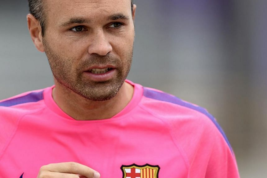 FC Barcelona's midfielder Andres Iniesta arrives at a press conference at the Sports Center FC Barcelona Joan Gamper in Sant Joan Despi, near Barcelona on July 25, 2014. -- PHOTO: AFP