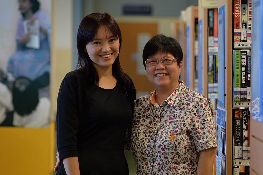 Library manager Michelle Kwok (left) with Mrs Kiang-Koh Lai Lin, a Queenstown librarian from 1980 to 1982. The building's exterior might not have changed much over the years, but the library has kept up with the times in its efforts to draw in reader