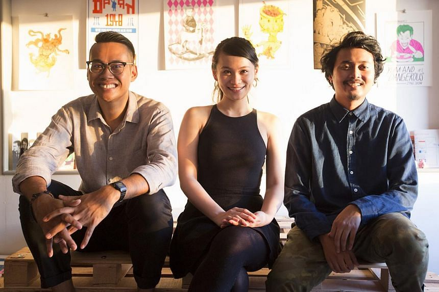 The team from risograph press Knuckles And Notch (from left) Mr Muhammad Izdi, Ms Marilyn Yunjin and Mr Djohan Hanapi. -- PHOTO: LOUIS KWOK