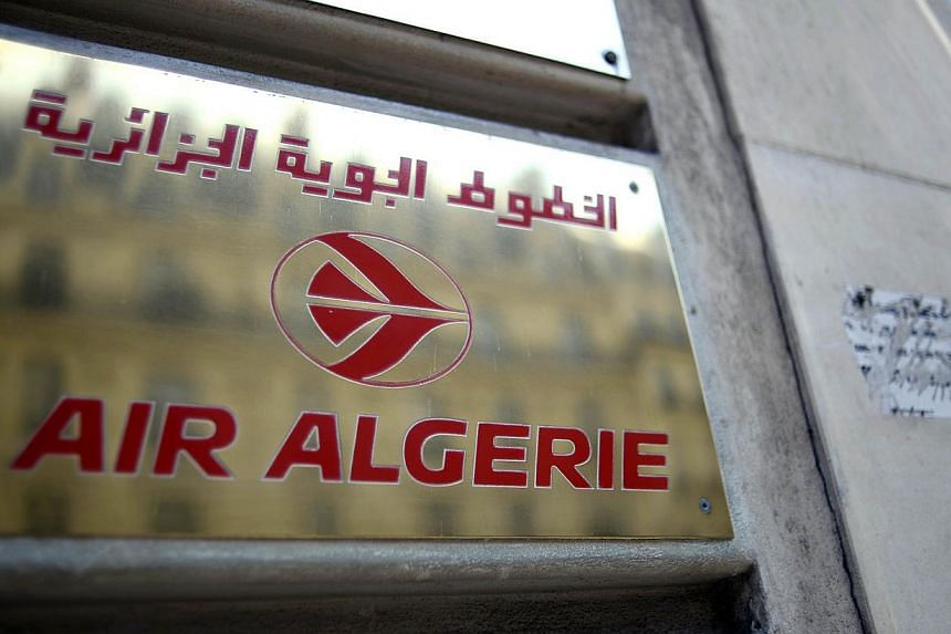 A photo taken on July 24, 2014 shows a plaque of an Air Algerie airlines office in Paris. Many French nationals are thought to be on board an Air Algerie jet that went missing after taking off from Burkina Faso for Algiers, French Transport Minister