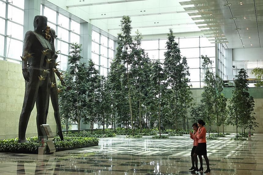 Sculptures and a green forest in Changi Airport's Terminal 3.-- PHOTO: ST FILE