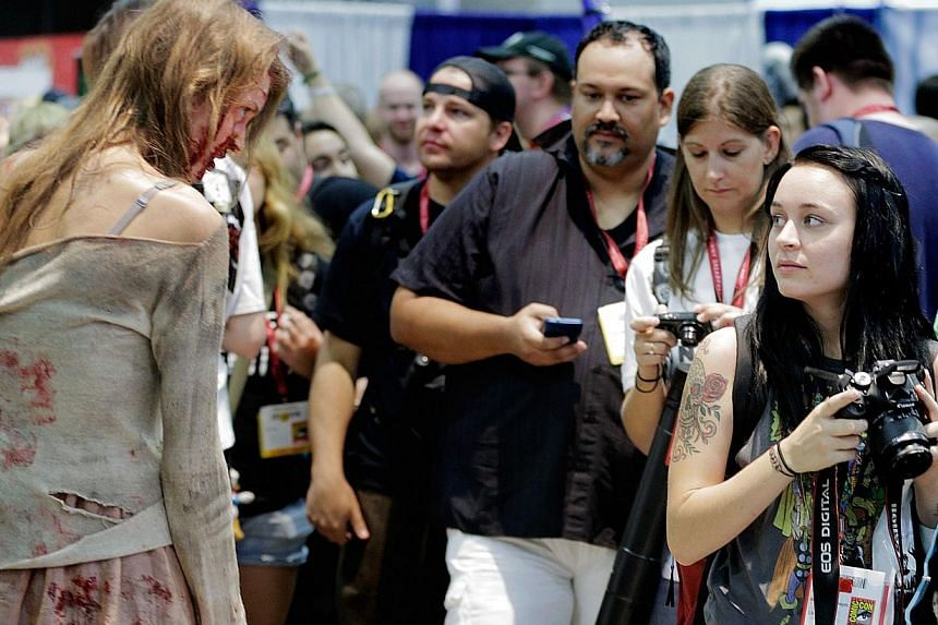 A zombie character from the TV show The Walking Dead approaches the attendees during the 45th annual San Diego Comic-Conin San Diego, Californiaon July 24, 2014. -- PHOTO: AFP
