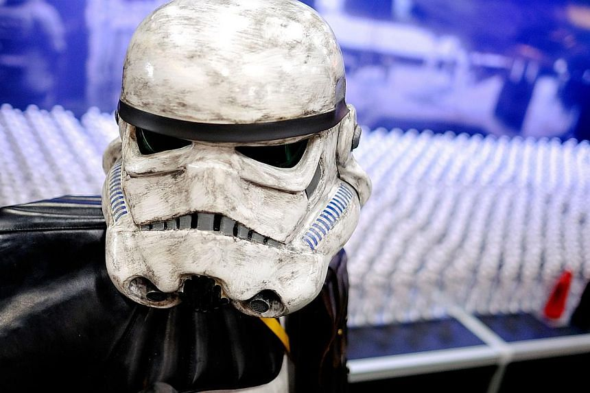 A Stormtrooper stands by a display of Star Wars figurines in the exhibitor hall during the 45th annual San Diego Comic-Conin San Diego, Californiaon July 24, 2014. -- PHOTO: AFP