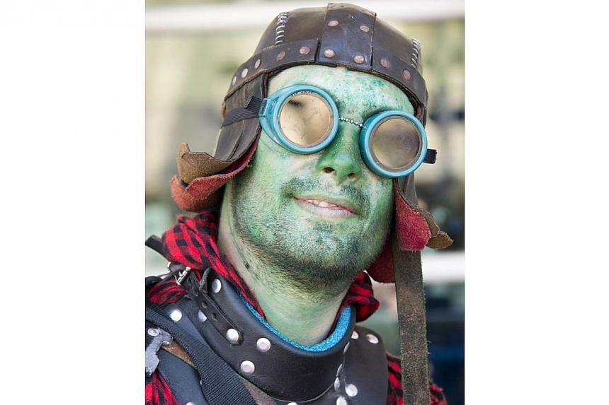 """Matthew """"Bacchus"""" Lister poses in costume on the first day of the 45th annual San Diego Comic-Con, in San Diego California on July 24, 2014. -- PHOTO: AFP"""