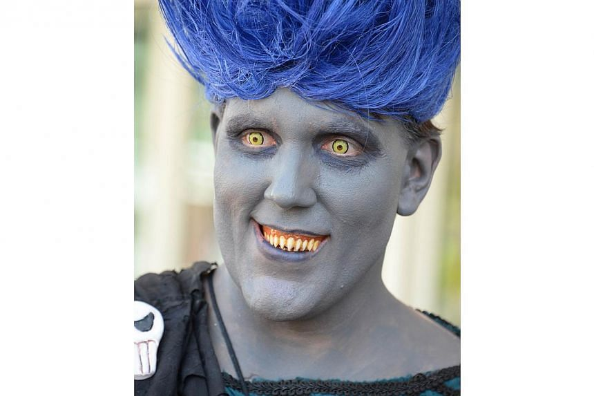 An attendee dressed as the Disney villian Hades the first day of the 45th annual San Diego Comic-Con, in San Diego California on July 24, 2014. -- PHOTO: AFP