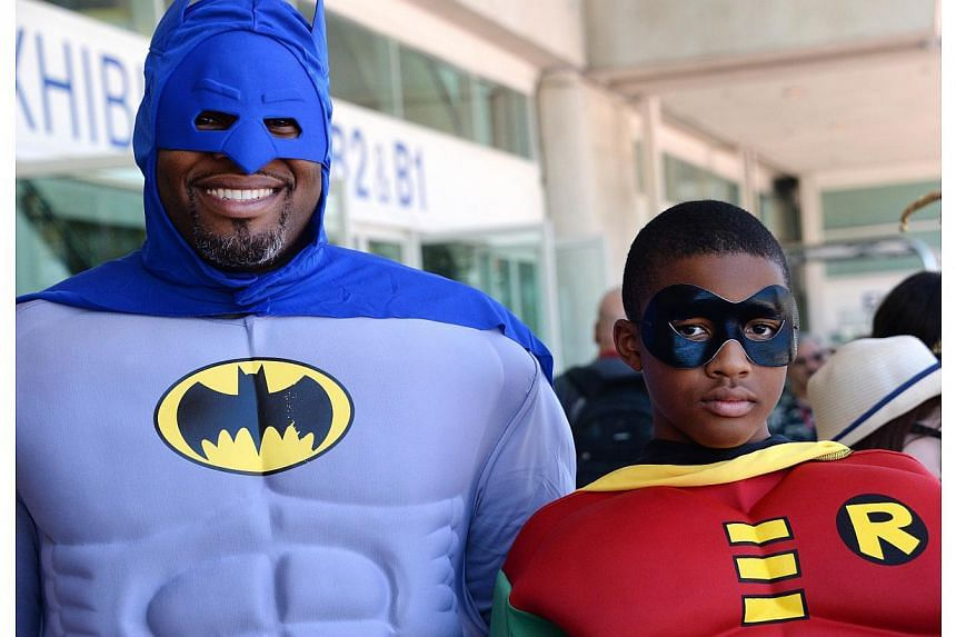 Erien Hodge and his son Adonis Hodge, 13, are dressed as Batman and Robin on the first day of the 45th annual San Diego Comic-Con, in San Diego California on July 24, 2014. -- PHOTO: AFP