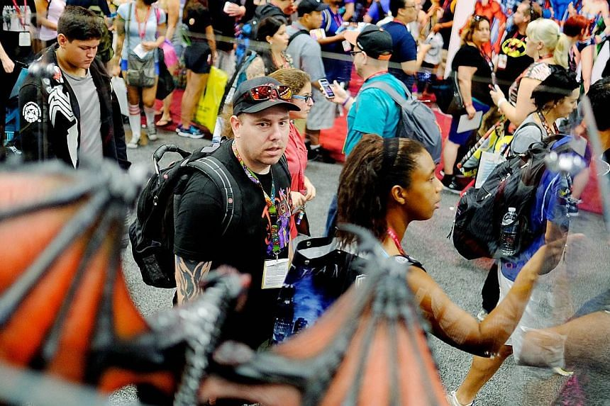 Attendees pass by a dragon figurine during the 45th annual San Diego Comic-Conin San Diego, Californiaon July 24, 2014. -- PHOTO: AFP