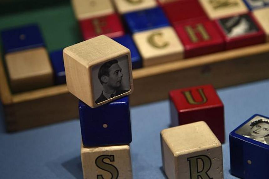 Building blocks belonging to Prince Charles as a child are seen on display at Buckingham Palace - the official residence of Britain's Queen Elizabeth - in central London on July 24, 2014. -- PHOTO: REUTERS