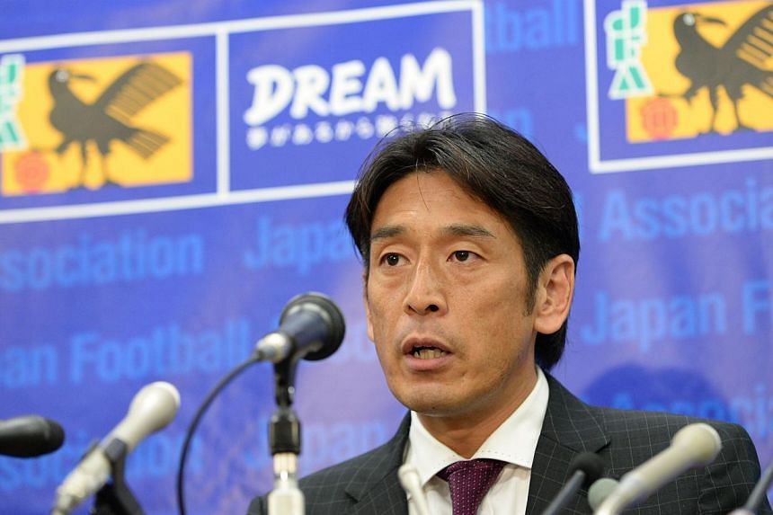 Japan Football Association (JFA) referee Yuichi Nishimura answering a question during a press conference at the JFA headquarters in Tokyo, on July 24, 2014. -- PHOTO: AFP