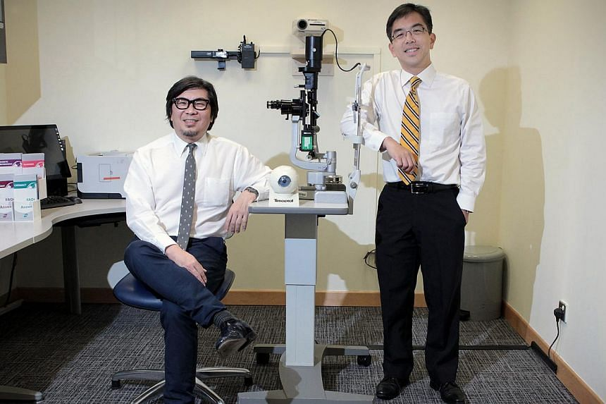 Professor Donald Tan (left) and Professor Wong Tien Yin from the Singapore National Eye Centre. Prof Tan will relinquish his post as medical director of the Singapore National Eye Centre, with Prof Wong taking over from Aug 1, or next Friday. -- ST P