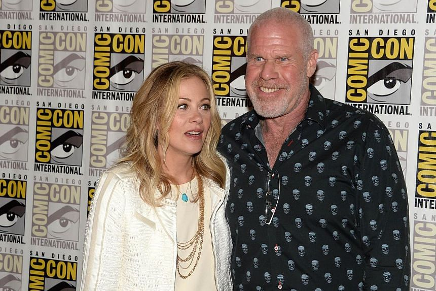 Actors Christina Applegate (left) and Ron Perlman attend the press line for 20th Century Fox's The Book Of Life, on the second day of the 45th annual Comic-Con, in San Diego, California on July 25, 2014. -- PHOTO: AFP