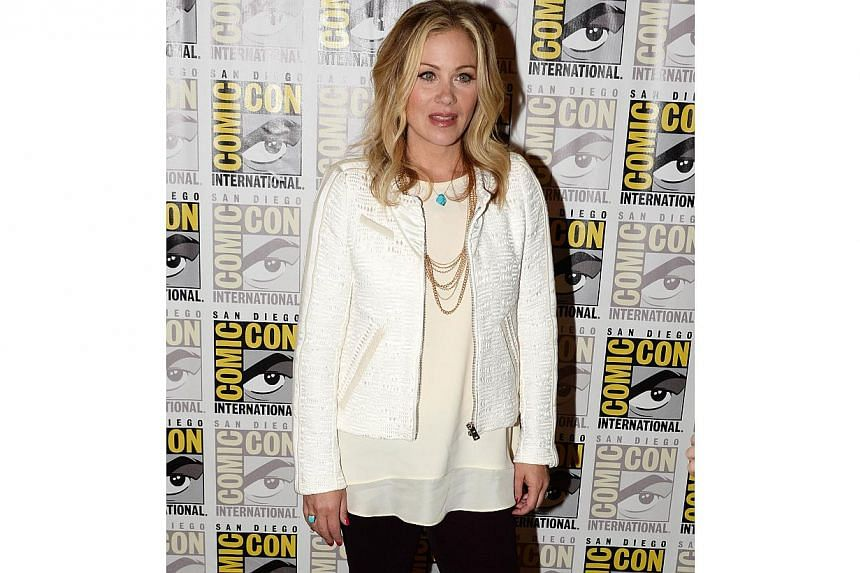 Acttress Christina Applegate attends the press line for 20th Century Fox's The Book Of Life, on the second day of the 45th annual Comic-Con, in San Diego, California on July 25, 2014. -- PHOTO: AFP