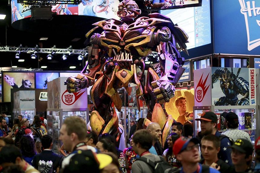 A Transformers statue stands on display at the Hasbro booth during the 2014 Comic-Con International Convention in San Diego, California on July 25, 2014. -- PHOTO: REUTERS