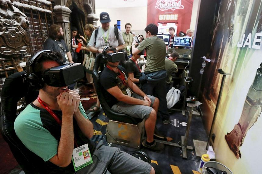 Attendees wearing Oculus Rift virtual reality headsets view a 3-dimensional video for the Pacific Rim: Jaeger Pilot video game during the 2014 Comic-Con International Convention in San Diego, California on July 25, 2014. -- PHOTO: REUTERS