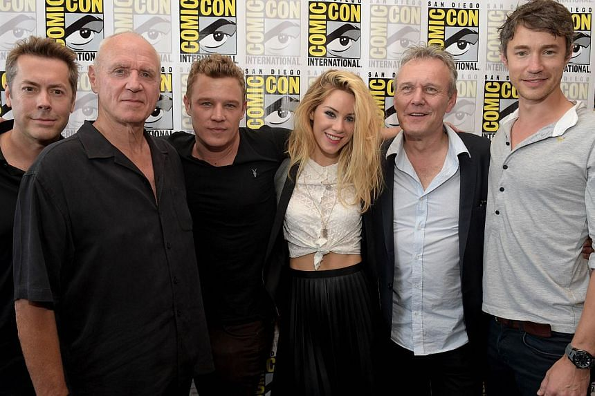 (From left) Executive producer Vaun Wilmott, actor Alan Dale, actor Christopher Egan, actress Roxanne McKee, actor Anthony Head, and actor Tom Wisdom attend the Dominion Press Line during Comic-Con International 2014 at Hilton Bayfront in San Diego,