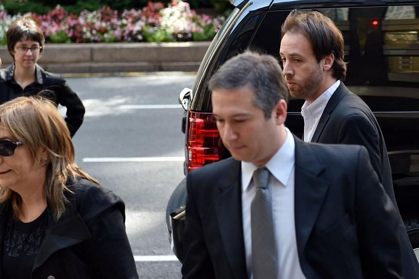 Argentina's Finance Secretary Pablo Lopez (right) arrives with attorneys Angelina Abonna (left) and Javier Pargament (centre) at the office building of mediator Daniel Pollack on July 25, 2014 in New York as talks continue into Argentina's debt. -- P