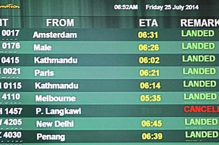 It was a bittersweet close to MH17 as the last plane bearing the call number touched down at Kuala Lumpur International Airport (KLIA). -- PHOTO:THE STAR/ASIA NEWS NETWORK