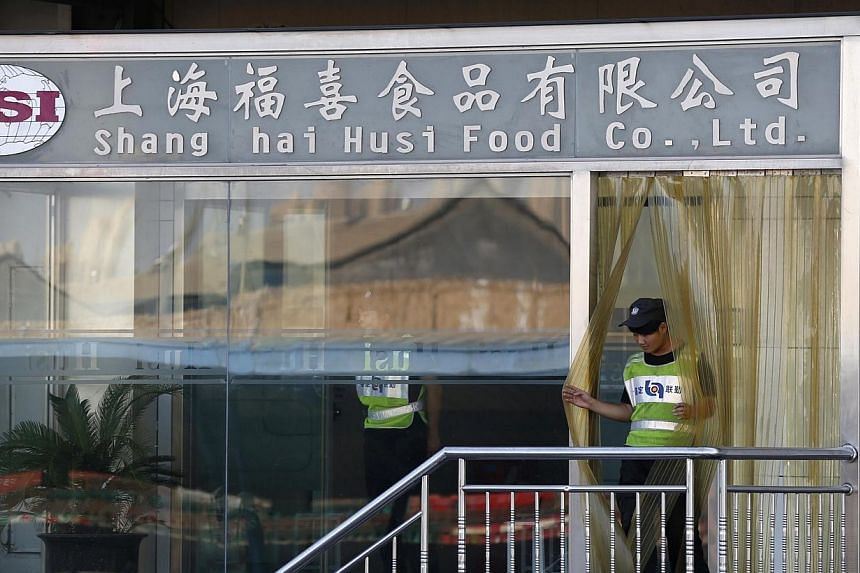A man walks out of the entrance of Husi Food factory in Shanghai on July 23, 2014. Regulators in Shanghai have found that a scandal-hit China-based food supplier forged production dates on some of its products and sold them after their expiry, t