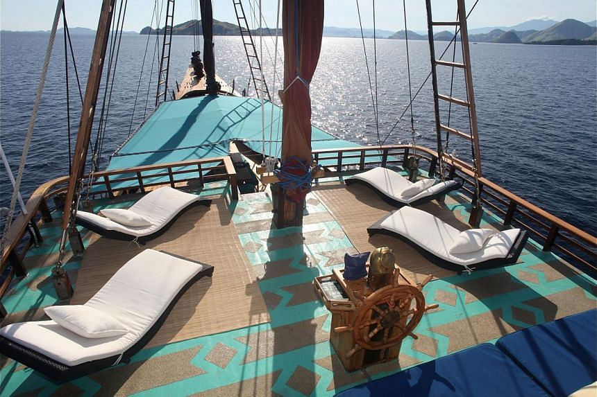 Travel writer Lee Siew Hua sailed on Tiger Blue, a traditional Bugis schooner decked out with modern luxuries. -- PHOTO: TIGER BLUE