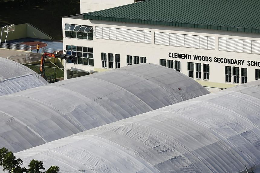 Tanglin Secondary (right) and Clementi Woods Secondary (far right), both located on West Coast Road, will be merging in 2016.