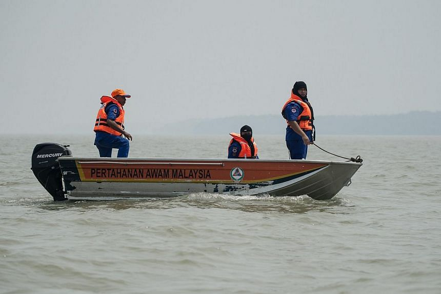 A file picture taken on June 19, 2014 shows Malaysian search and rescue teams carrying out a search operation near the area where a boat carrying Indonesian illegal migrants sank overnight in seas near Banting. Malaysia is offering illegal Indonesian