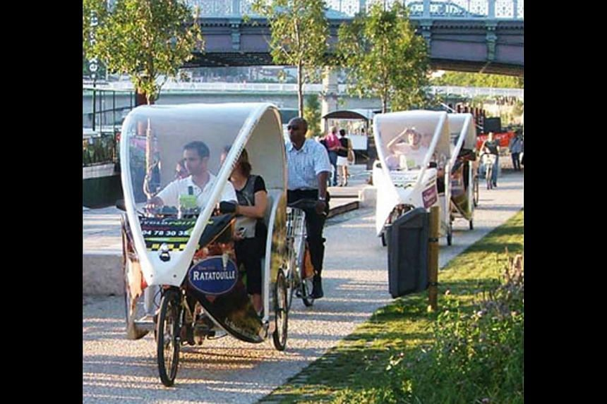 Cyclopolitains: These modern electric tricycles (above) are driven by young drivers called Cyclonauts who are friendly and double as tour guides. It costs €1 a kilometre a person. -- PHOTO: LYON TOURISM AND CONVENTIONS