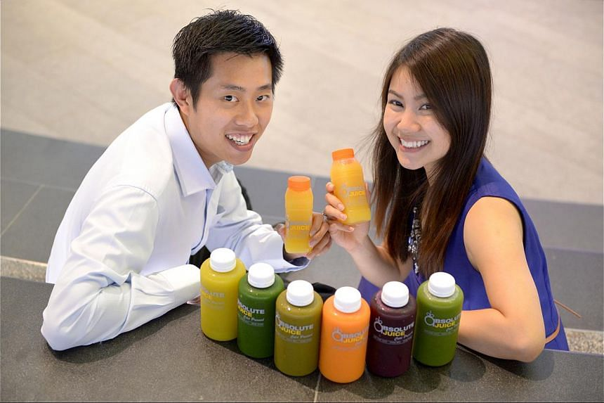Ms Britney Cheong, a public officer, and her fiance Glenn Lee (both above), a bank employee, went for a three-day juice cleanse in May with Absolute Juice. -- ST PHOTO: LIM SIN THAI