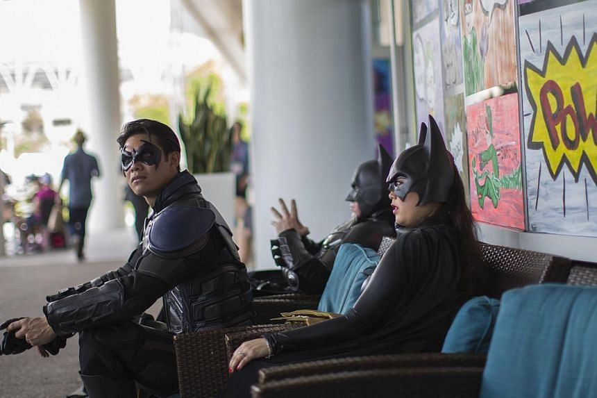 People dressed like characters from the Batman movies are pictured during the 2014 Comic-Con International Convention in San Diego, California on July 25, 2014. -- PHOTO: REUTERS