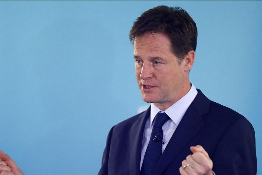 Britain's Deputy Prime Minister and leader of the Liberal Democrats, Nick Clegg, delivers a speech on international development, in London on May 28, 2014.Clegg joined calls on Sunday for Russia to be stripped of the World Cup in 2018 following