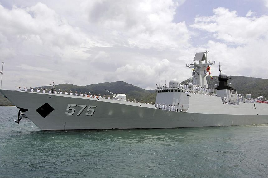 Chinese navy sailors waving as Chinese naval missile frigate Yueyang departs for an exercise at a military port in Sanya, Hainan province on June 9, 2014. -- FILE PHOTO: REUTERS
