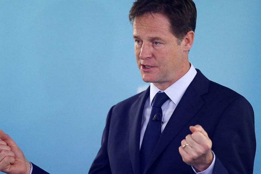 Britain's Deputy Prime Minister Nick Clegg said that Russia should forfeit the right to stage the 2018 World Cup Finals following the destruction of the Malaysian Airlines jet in Ukraine. -- PHOTO: REUTERS