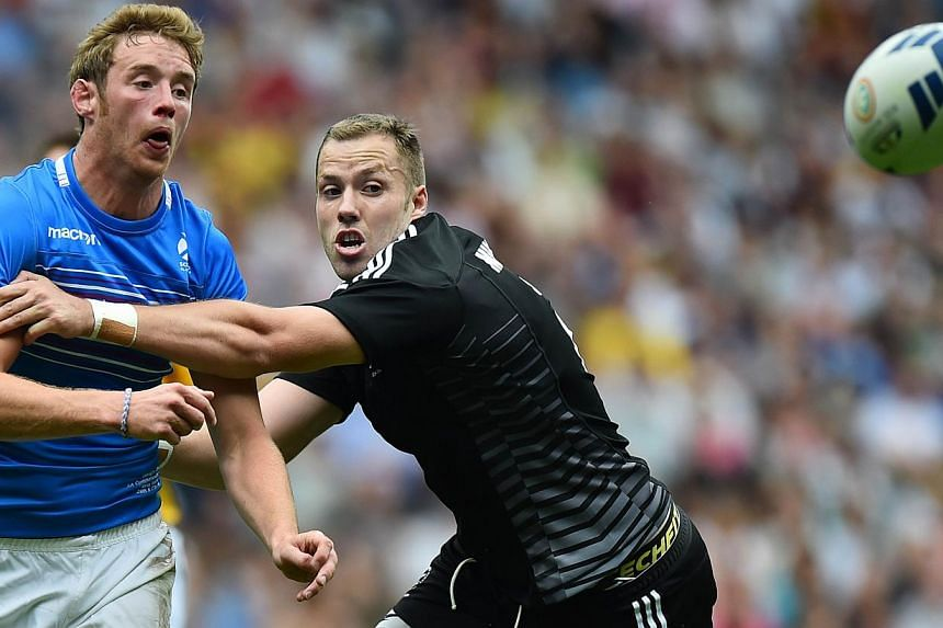 New Zealand's Tim Mikkelson (right) tackles Scotland's Scott Wrigh (left) during the Rugby Sevens pool A match between Scotland and New Zealand at Ibrox Stadium during the 2014 Commonwealth Games in Glasgow on July 26, 2014.Four-time champions
