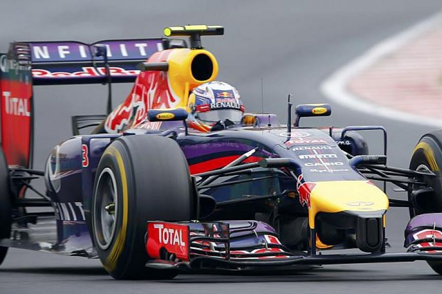 Red Bull Formula One driver Daniel Ricciardo of Australia drives during the Hungarian F1 Grand Prix at the Hungaroring circuit, near Budapest on July 27, 2014.  -- PHOTO: AFP